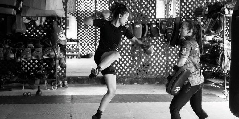 female muay thai fighter training - flying punch